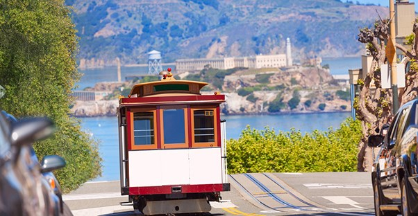 A streetcar trolley climbs up a hill in San Francisco.