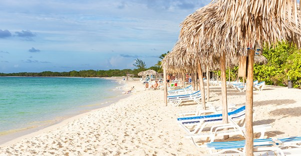 Resort chairs line the beach on Cayo Coco island in Cuba.