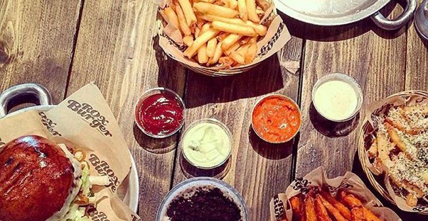 A spread of burgers and fries at Rox Burger in London, England.