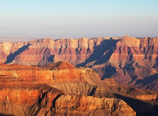 a landscape view of the Grand Canyon and its striped walls