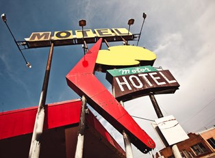 a sign for a motel along Route 66