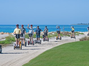 a segway tour of Sanibel Island passes by the ocean