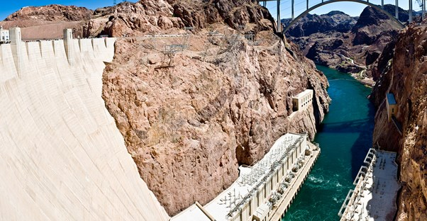 a view down the front of the hoover dam where water exits the generators