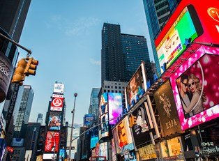 a panoramic view of the bright and colorful ad screens around Times Square
