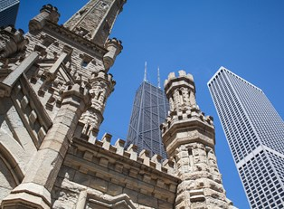a view of the John Hancock building from the foot of the Chicago Water Tower
