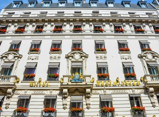 the many windows on the facade of a paris hotel
