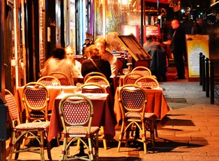 diners eat on the patio of one of Paris' famous restaurants