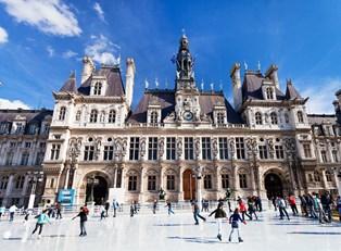 Paris visitors ice skate outside a famous landmark