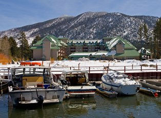 a lake tahoe resort is covered in snow