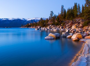 the rocky coastline along the calm waters of Lake Tahoe
