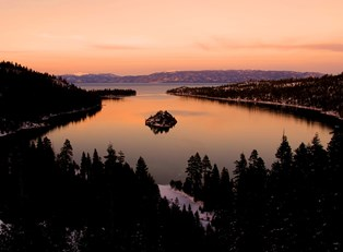 an aerial view of expansive Lake Tahoe at sunset