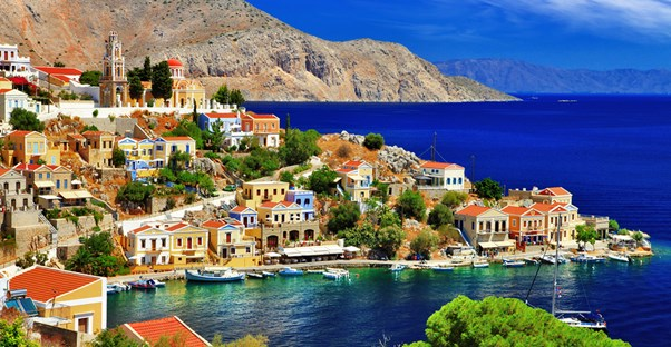 colorful vacation rental properties dot the Greek coastline