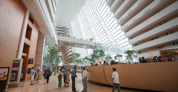 a large expansive atrium inside one of singapore's many hotels