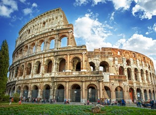 visitors tour the colosseum ruins in rome