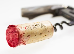 a wine cork is freshly pulled from a napa wine bottle