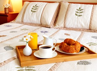 a breakfast tray is delivered to a sonoma bed and breakfast room