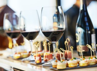 a spread of wine options and appetizers at a sonoma wine tasting