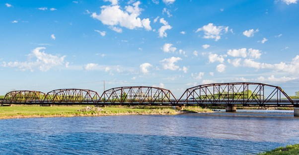 a bridge crosses a river along the oklahoma portion of route 66