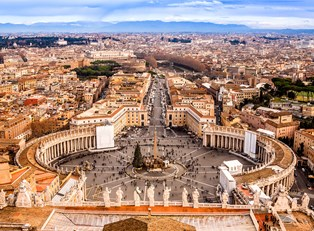 st. peter's square and it's roadway lead deep into the heart of Rome