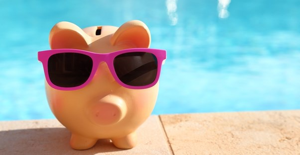 a piggy bank has saved money for travel to cuba