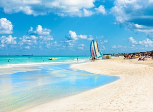 families explore and enjoy the sunny beaches of cuba
