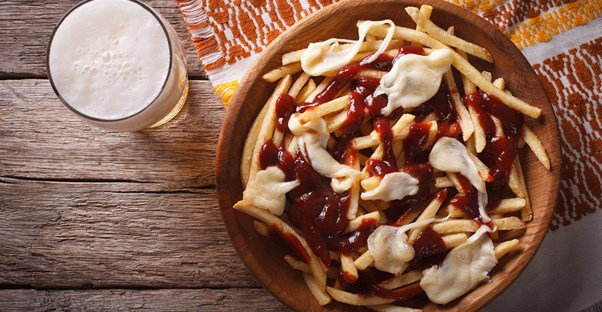 Poutine, a Canadian invention, needs to be assimilated into American culture.