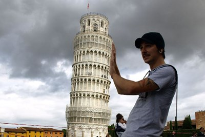 Pretending to hold up the Leaning Tower of Pisa is not a novel travel activity.