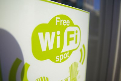 A free wi-fi sign denotes an area where budget travelers can save on internet usage.
