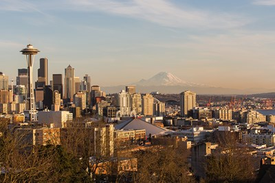 Downtown Seattle and the Space Needle are situated in front of Mount Rainier in the distance.