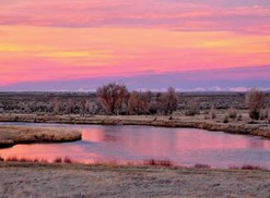 a pink sunset on the open expanse of wyoming