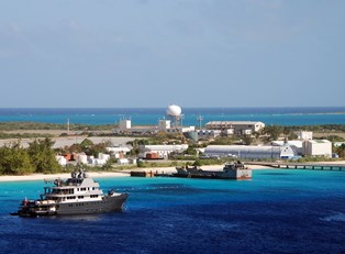 a ship in the harbor of a Turks and Caicos port