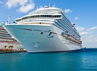 a large Carnival cruise liner docked in port