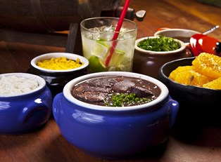 a table full of various Brazilian dishes