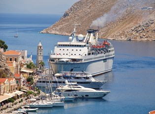 a greek cruise ship pulls up to port