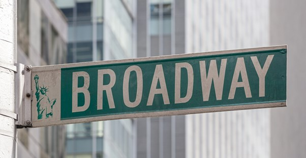 a street sign showing broadway in new york city