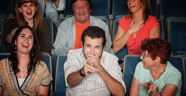 audience members laugh hysterically at a joke by a branson comedian