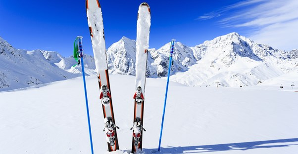 a pair of skis sticks out of the snow