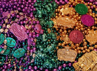 a pile of new orleans mardi gras beads