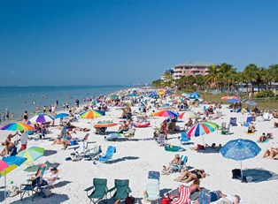 a popular spring break beach is filled with people