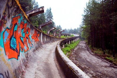 The bobsled track of Sarajevo is now abandoned and covered in graffiti.