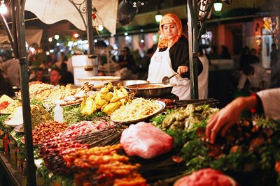 A street vendor cooks up interesting flavors in Marrakech Morocco.