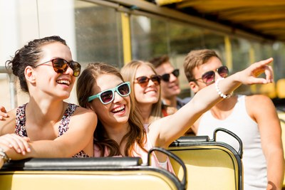 A family enjoys their 24 hour getaway aboard a sightseeing bus.