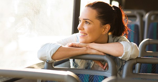 Woman enjoying bus ride