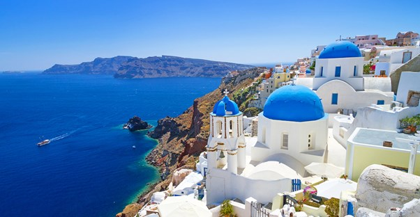 a beautiful view of a honeymoon destination on the Greek Mediterranean coast