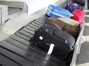 luggage sits on a conveyor belt ready to be picked up