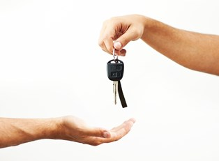keys to a rental car being handed over