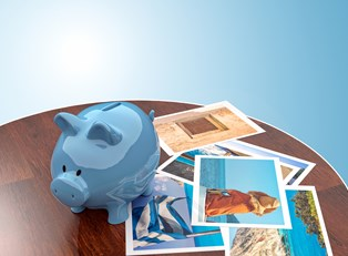 a piggy bank sits on a table with pictures of a family's travel