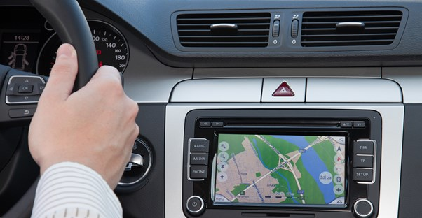 a driver views an in-car GPS system