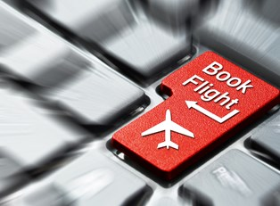 a computer keyboard with a button that says book flight