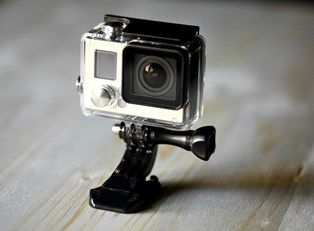 a GoPro camera sits on its stand